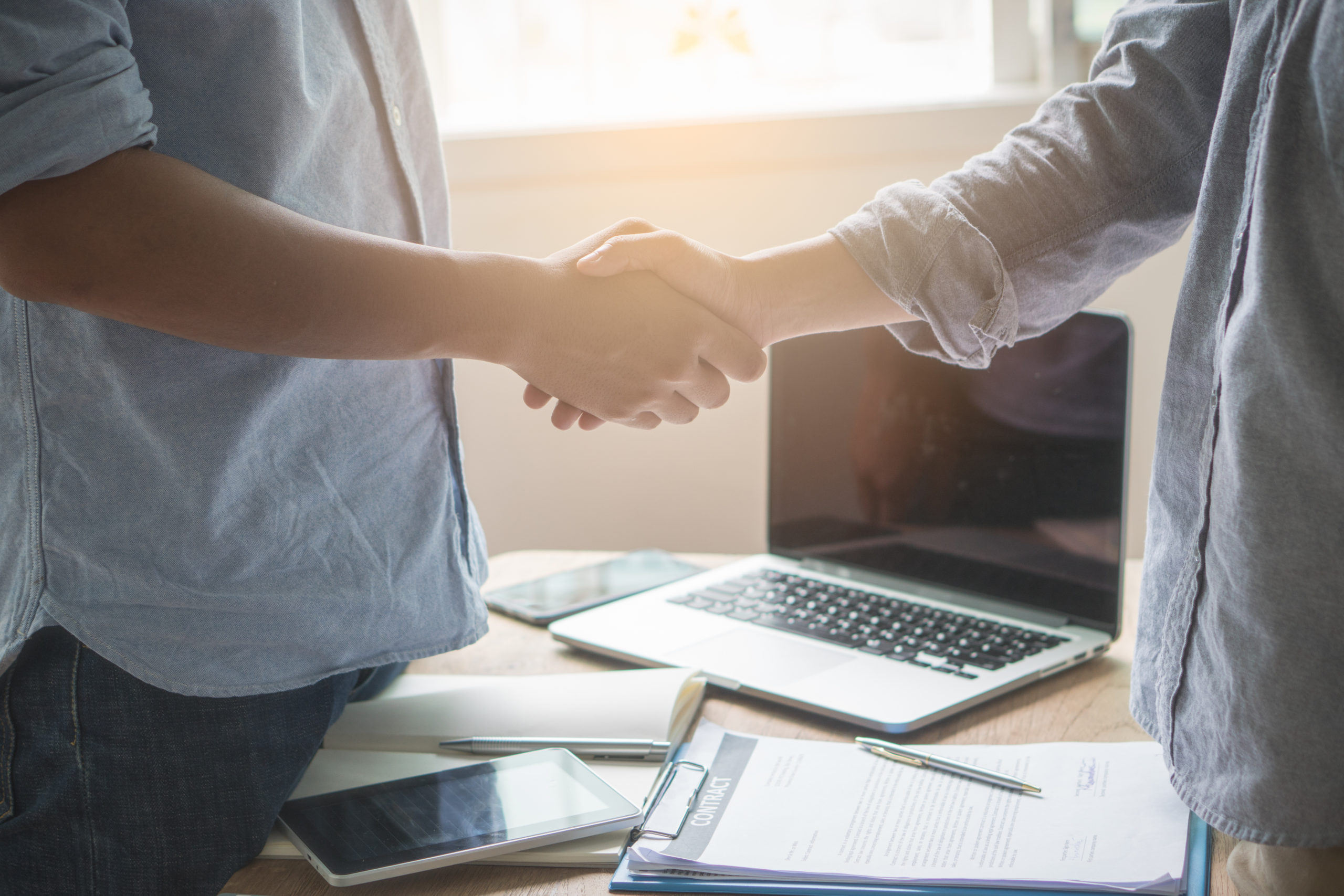 young startup businessman shaking hands with partners after agree a deal to collaborate.